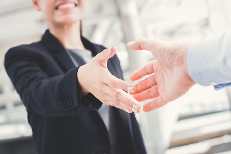 A handshake greeting