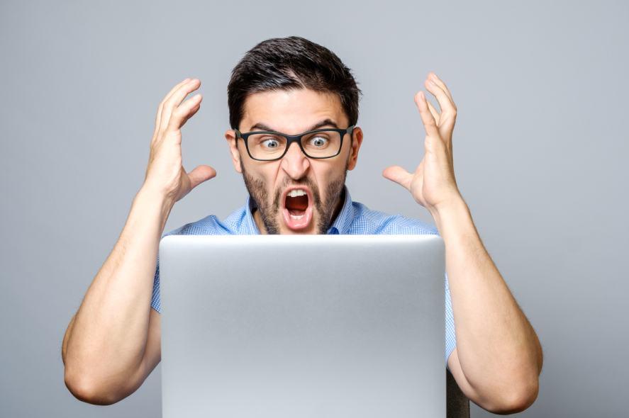 A man shouting at his computer