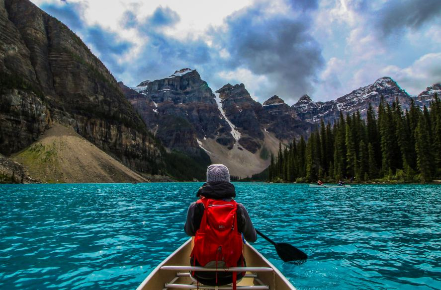 A person sailing in a canoe