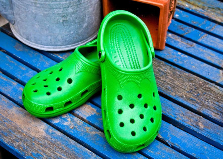 A pair of bright green Crocs clogs