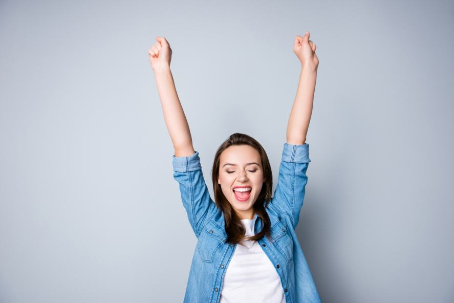 A young woman celebrates her success