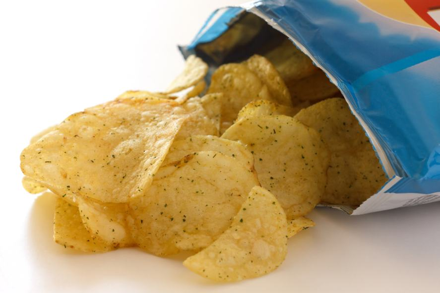 Packet of cheese and spring onion flavour crisps