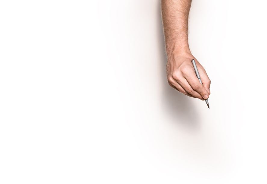 A male hand is ready to draw on a blank sheet of paper
