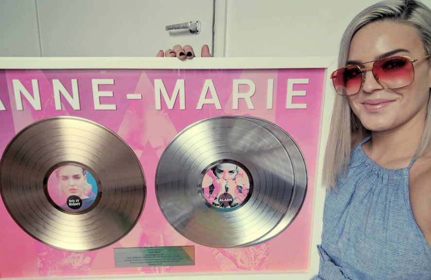Anne-Marie holding discs