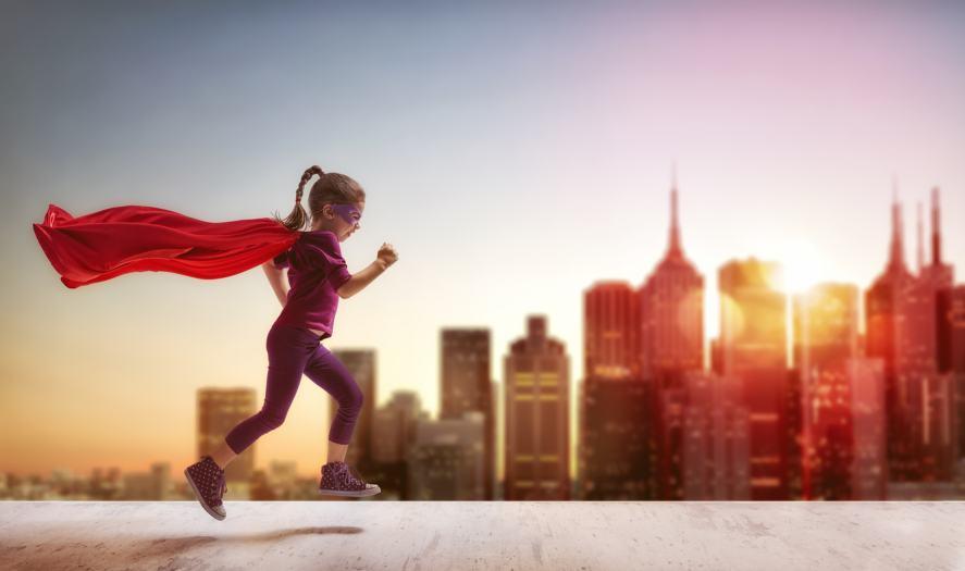 A young superhero dashing across the city