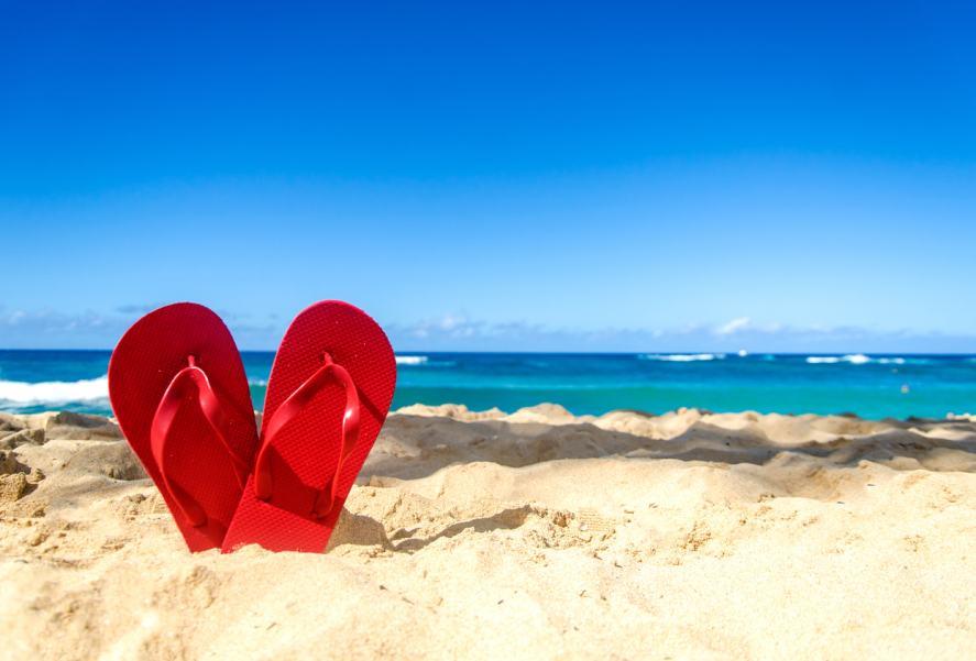 A pair of flip flops on the beach
