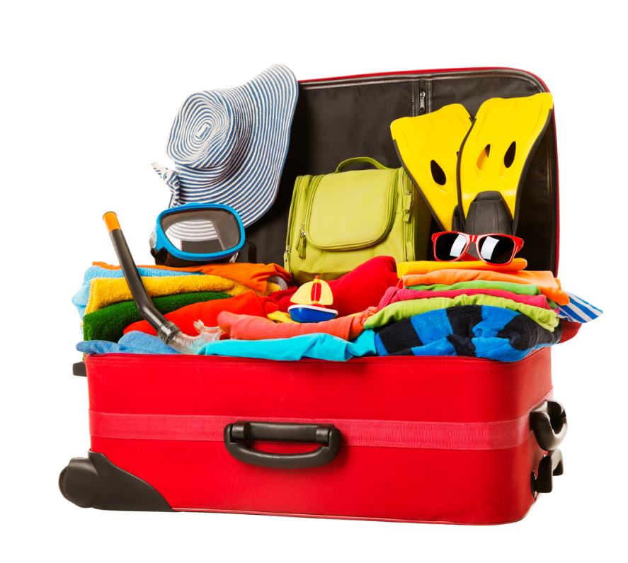 Suitcase stuffed with clothes for a summer holiday