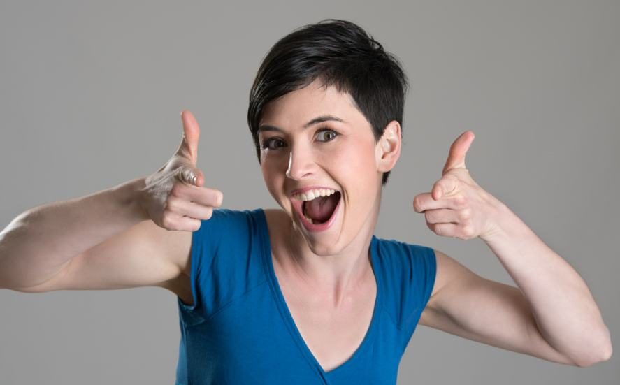 A woman giving the thumbs up
