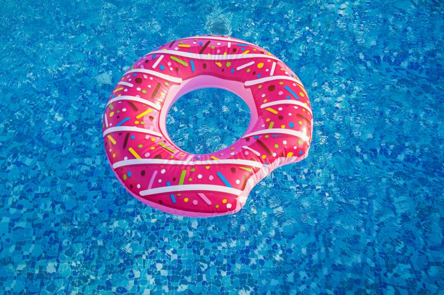 A donut-shaped pool float