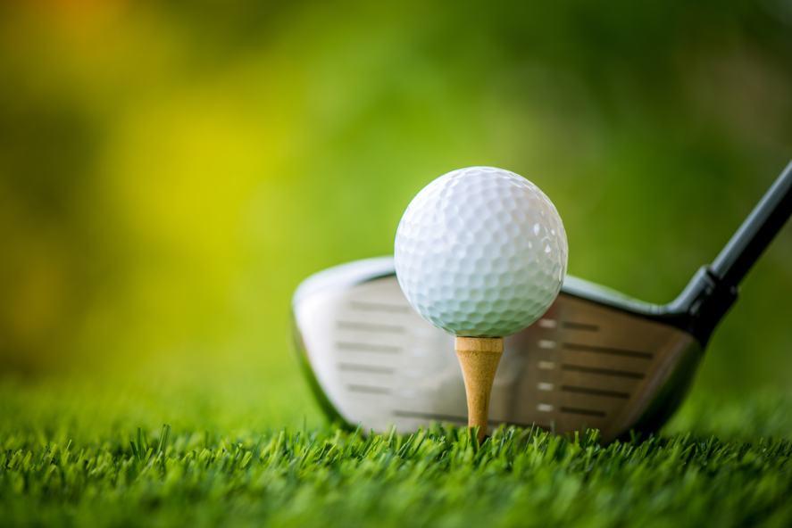 A golf ball and club