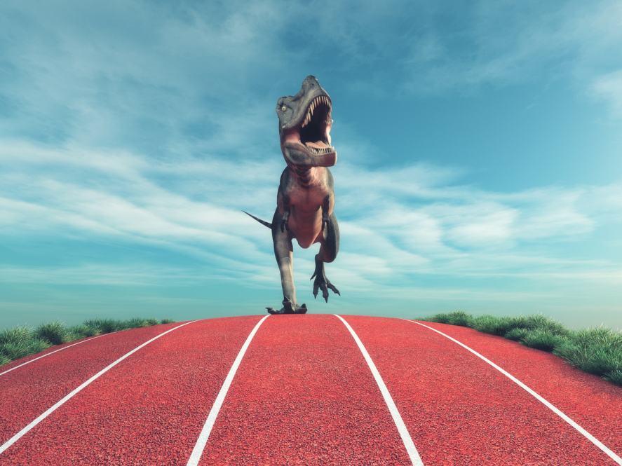A dinosaur running on a race track