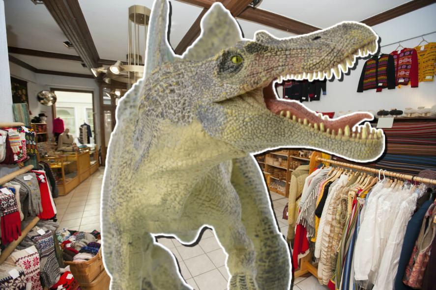 A dinosaur roams the gift shop
