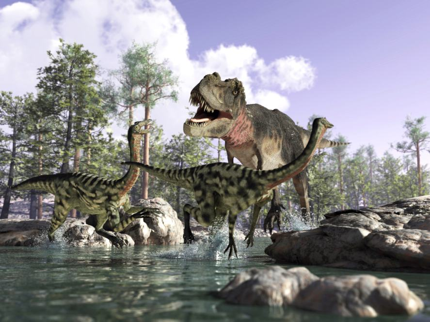 A group of dinosaurs relax next to a lake