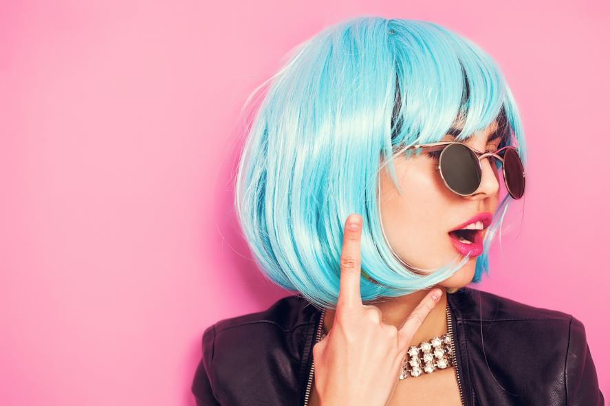 A woman with blue hair posing for a picture