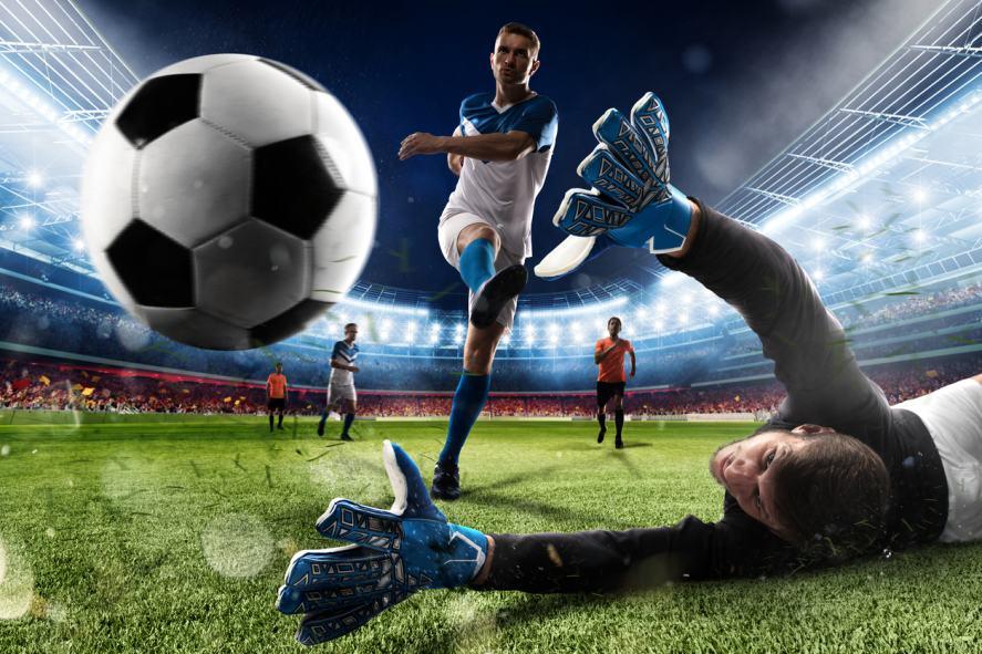 A football player scores a goal