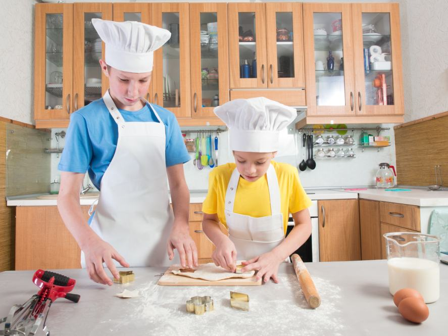Two people baking in a kitchen