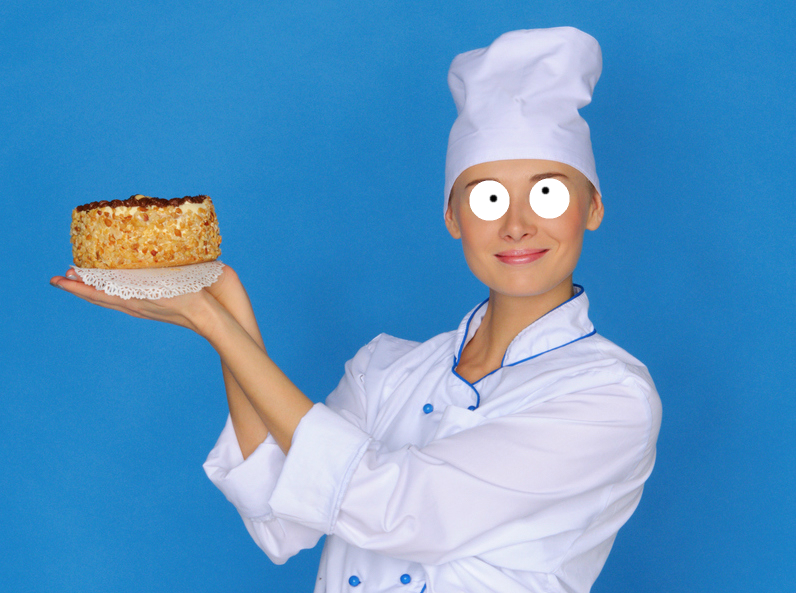 A baker holding a delicious cake
