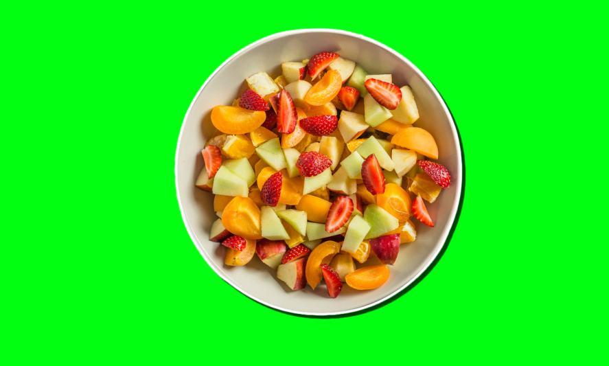 A bowl of chopped fruit