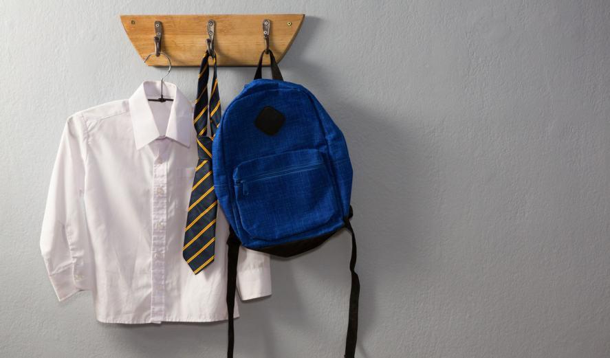 School uniform and schoolbag hanging on hook