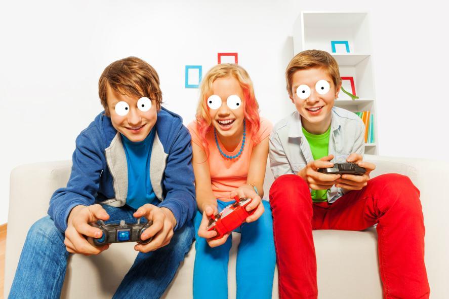 Three children play video games
