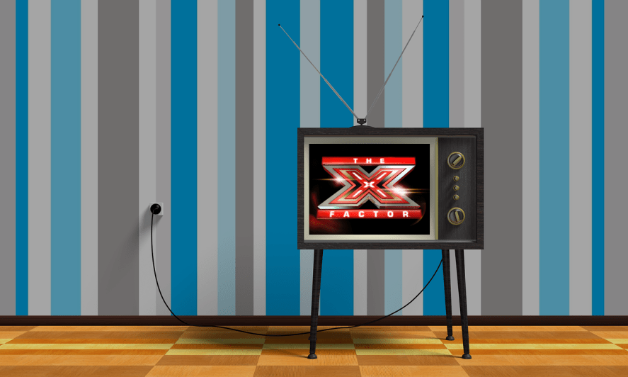 An old-fashioned TV with The X Factor on the screen