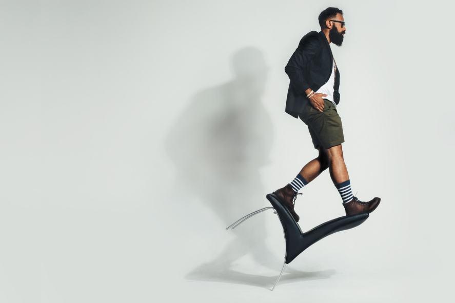 Man balancing on a chair