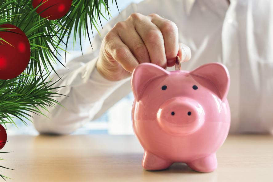 A person puts a coin into a piggy bank