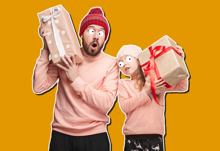 Two people holding big Christmas presents