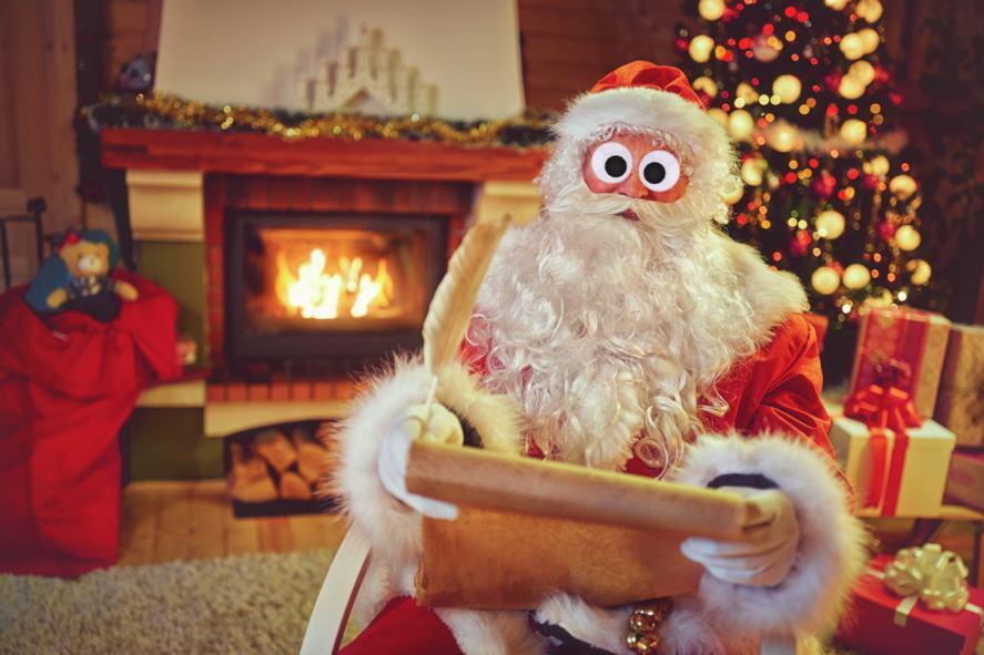 Santa looking at his list