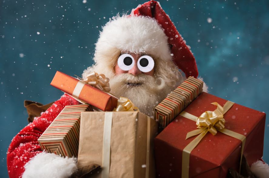 Santa Claus with an armful of gifts