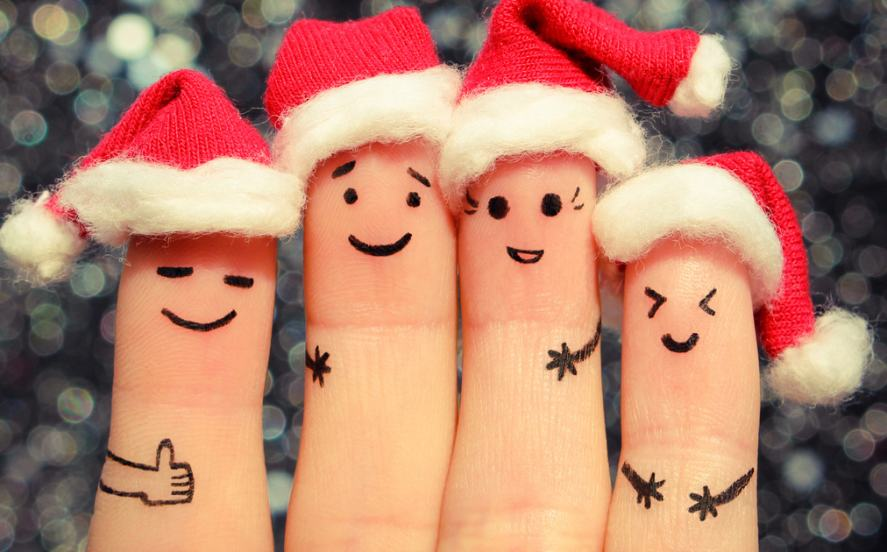A group of fingers wearing Santa hats
