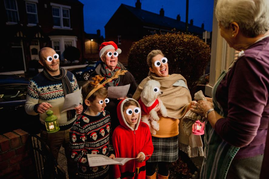 A group of carol singers at someone's door