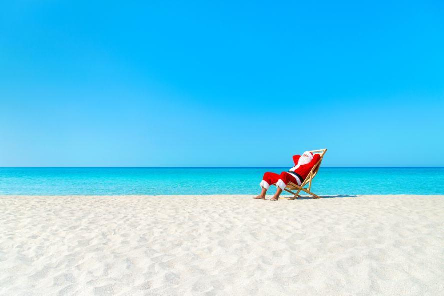Santa relaxing on a beach