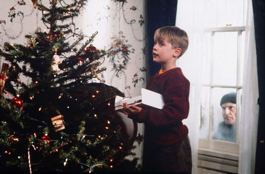 Home Alone –a burglar peers through the window of the McAllister house