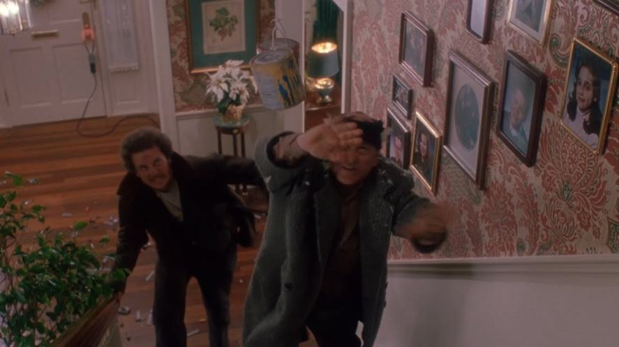 The burglars climb the stairs in Home Alone