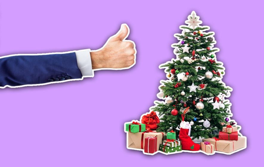 Person giving a well decorated tree a thumbs up
