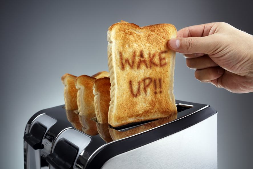 A piece of toast with 'Wake Up!' burned into it