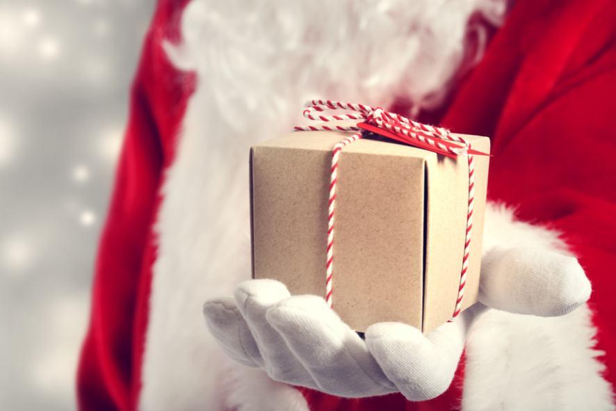 Santa holding a small gift