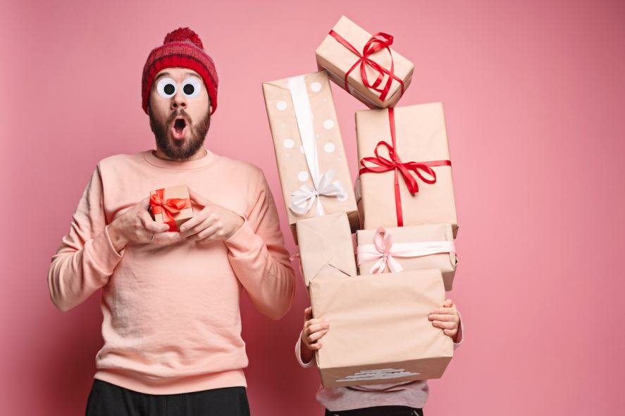 Two people laden with Christmas presents