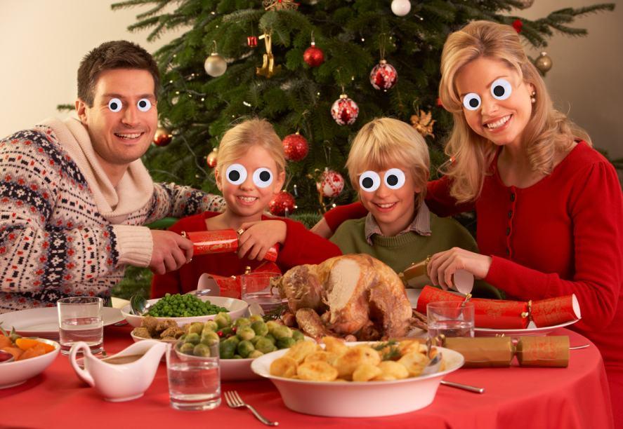 A family enjoying some Christmas crackers