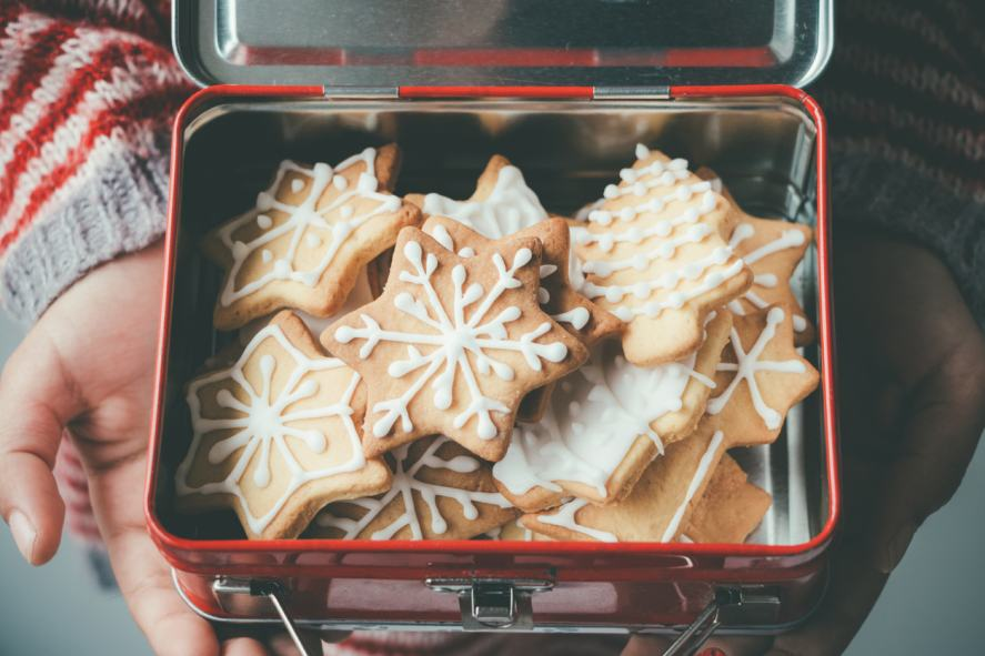 A tin of snowflake-shaped biscuits