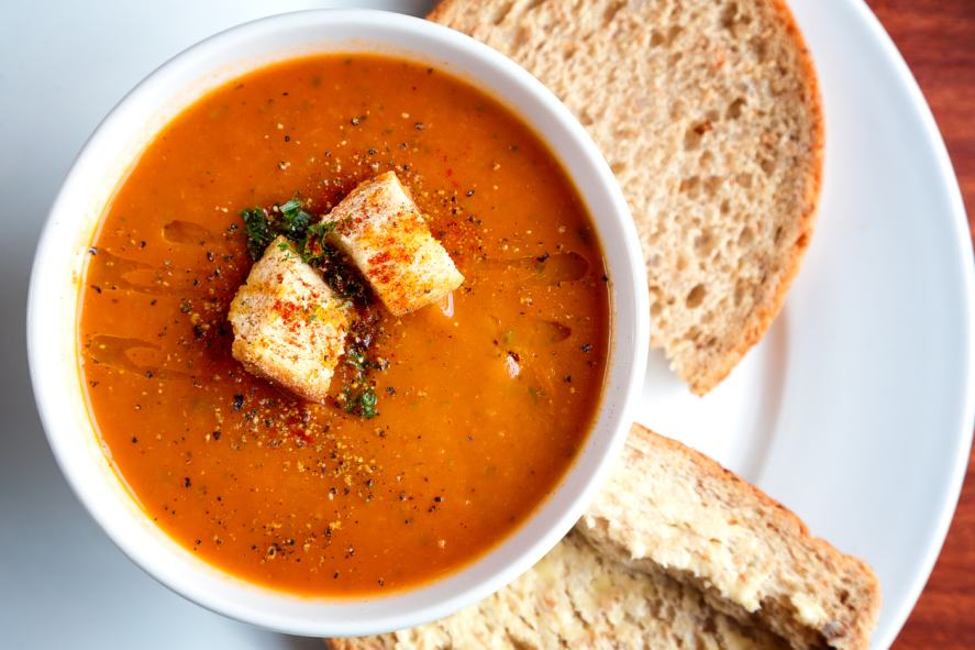 A big bowl of tomato soup and croutons