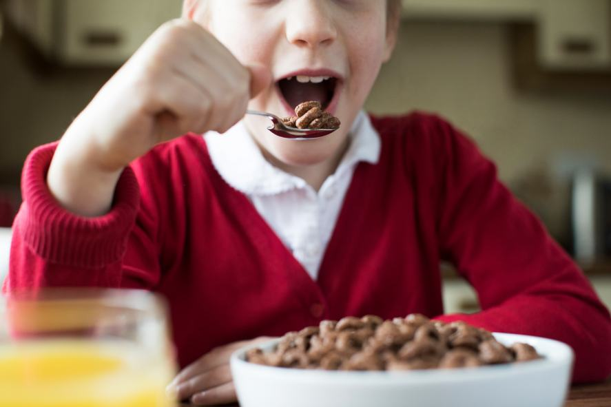 A child eating a bowl of cereal