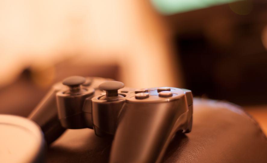 A PS4 controller on a sofa
