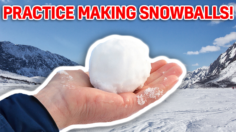 A picture of someone holding a perfect snowball!