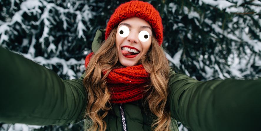 A young woman taking a selfie in the snow