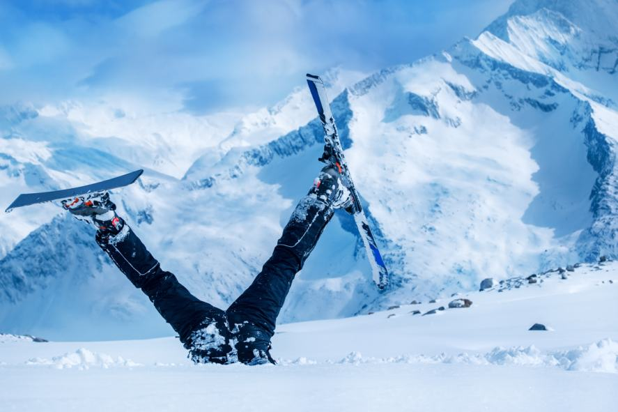 A skier upside down in the snow