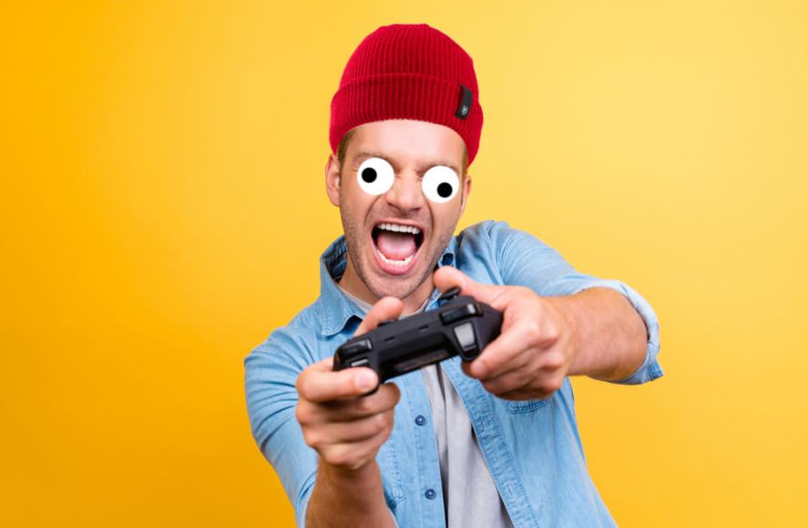 A gamer wearing a big wooly hat