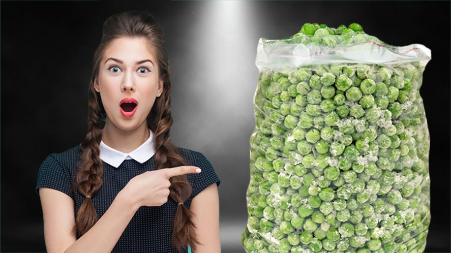 A woman points to a bag of frozen peas