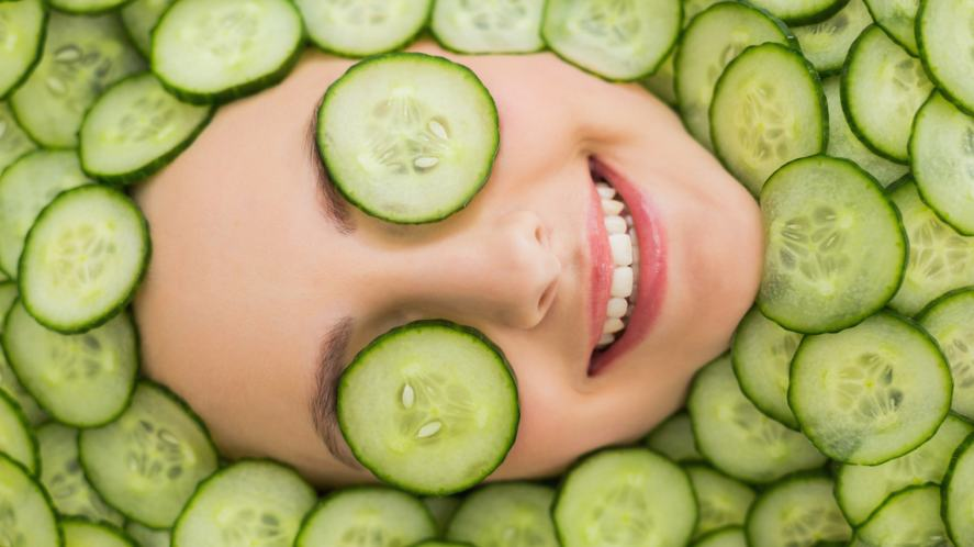 A woman relaxing with slices of cucumber over her eyes